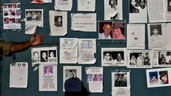 Portraits of missing pilgrims are seen on the gates of the Jolly Grant Airport in Dehradun, Nepal, on June 26, 2013 (source).